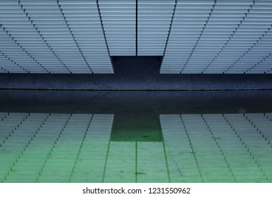 A facade reflected in the water. Abstract background.