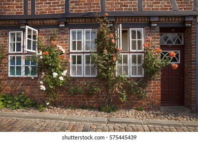 Facade with roses, Lower saxony, Germany, Europe