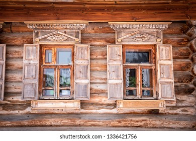 The facade of the Russian wooden house with two windows
