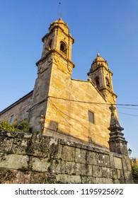 Facade of Saint Benito church illuminated at sunset in Cambados, Galicia