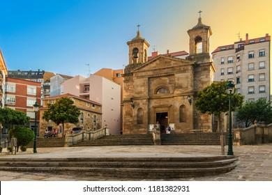 Facade of Santa Uxia church in Riveira city at sunset