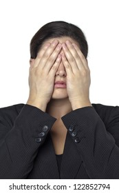 Facade shot of a businesswoman covering her eyes using her hands