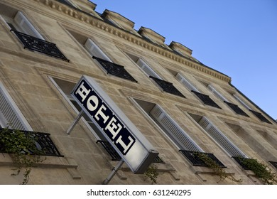Facade and sign of a vintage hotel in France