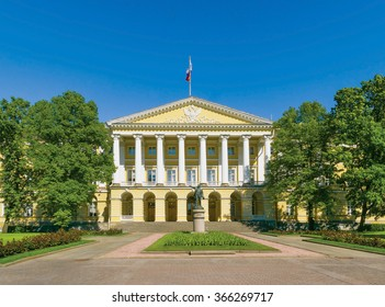 Facade of the Smolny Institute (the official residence of the governor of St.Peterburg now) with a Lenin statue in the foreground. Russia