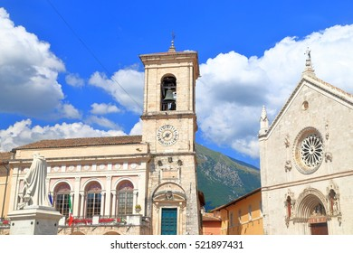 Facade of St Benedict church and historical buildings in Piazza San Benedetto, Norcia, region of Umbria, Italy