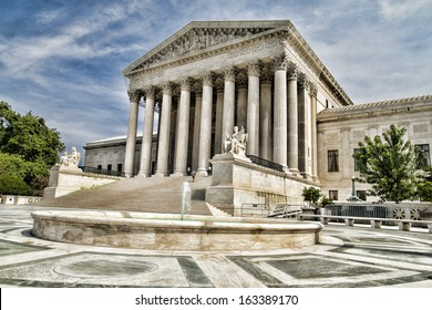 The facade of the Supreme Court of The United States of America in Washington DC.