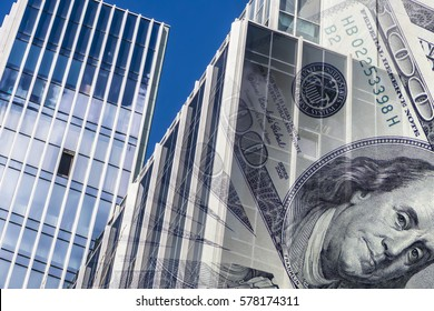 The facade of a tall building in the background of the Bank bills . The concept of development of the real estate market