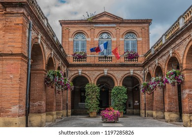 Facade of the town hall of Saint Ybars with its flags in the region of Midi-Pyrenees district of Pamiers. Ariege France