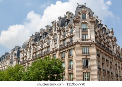 Facade of a traditional apartment building in Paris, France