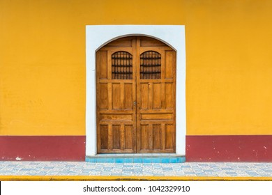 Facade of traditional and colorful housing in Granada city, Nicaragua, Central America.