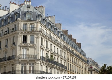 Facade of a traditional living building in Paris, France