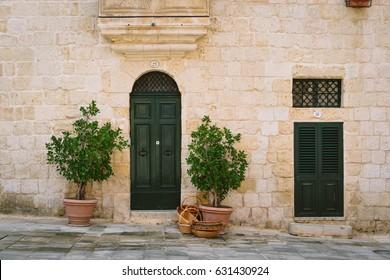 Facade of traditional maltese house in Mdina, Malta
