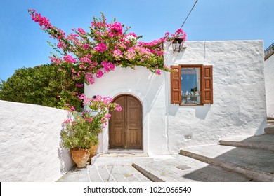 Facade of traditional white house in Lindos town at Rhodes island