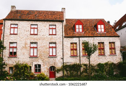 Facade of typical brick houses in Bruges, Belgium