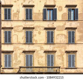 Facade of typical italian house with balcony