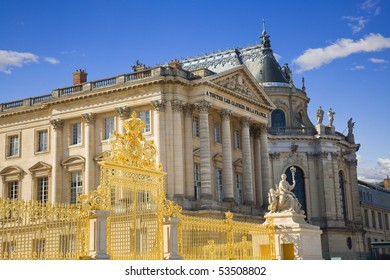 Facade of Versailles Chateau with it's golden door in first line