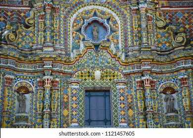 Facade view of the Baroque architecture Temple of San Francisco Acatepec with colorful Talavera ceramic tiles in Cholula, Puebla Mexico.