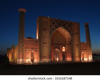 facade view with classic uzbek tiles and islamic mosaics of Ulughbek Madrassah, sunset in Registan Square, Samarkand, Uzbekistan