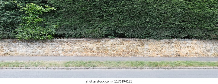 Facade of a vintage stone wall fence.