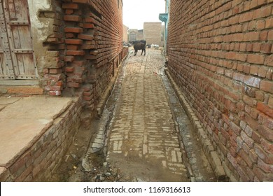 facade and wall of an old house in india town of Govardhan