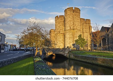 Facade of the West Gate of Canterbury reflected in River Stour at sunset