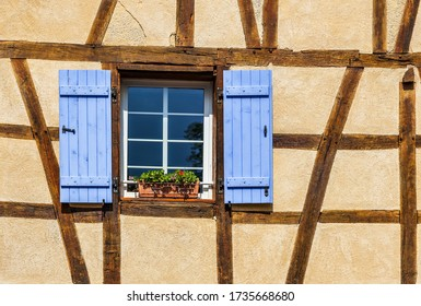 Facade with window on a traditional house in a historical city of Colmar, France