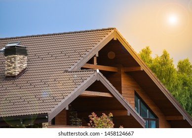 The facade of the wooden house in modern style. Natural photo.