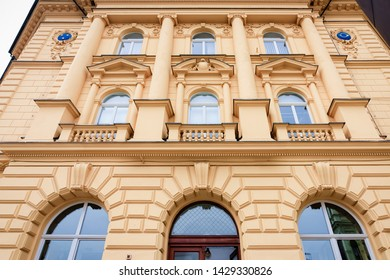 Facade of yellow building in Celje old town in Slovenia. House architecture in Slovenija.