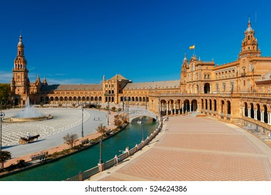Facades of buildings on the Spanish square or the Plaza de Espana. Andalusia.