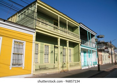 Facades of houses in the Calle Baquedano in the typical architecture style of Iquique, North Chile, South America