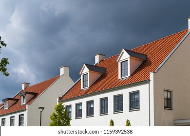 facades of identical white residential houses in the netherlands
