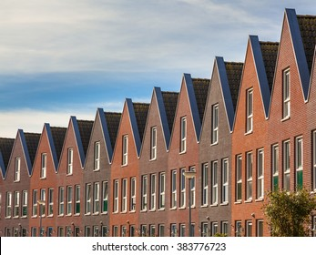 Facades of Modern Real Estate Family houses in a row