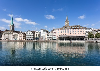 The facades of traditional building reflecting in the Limmat river in Zurich old town in Switzerland on a sunny summer day