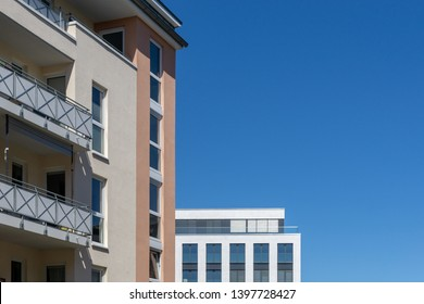 facades of two buildings - blue sky - without clouds