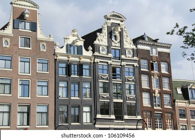 Facades of the typical houses in Amsterdam , Netherlands ( Holland )