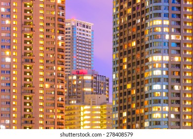 Facades and windows of high-rise buildings at night