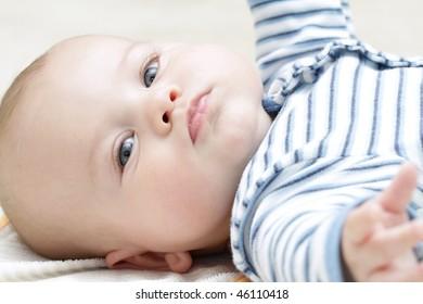 Face of an adorable blue eyed baby boy