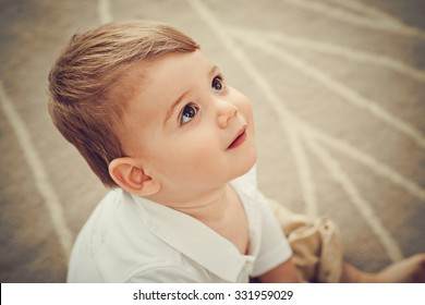 Face of adorable little kid looking up
