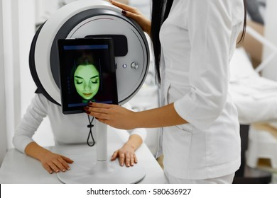 Face Analysis. Closeup Of Female Getting Full Facial Skin Analysis Using Professional Beauty Equipment. Beautiful Young Woman Does Digital Diagnostics. Cosmetology And Dermatology. High Resolution