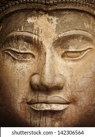 Face of the ancient stone Buddha close up