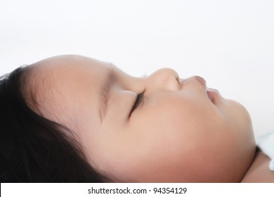 Face of a baby sleeping, profile view