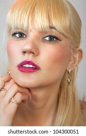 face of beautiful blonde woman, she looks on