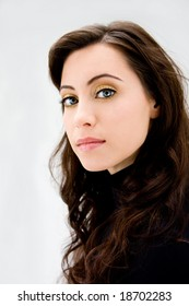 Face of a beautiful blue eyed brunette, isolated
