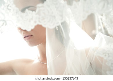 face of a beautiful bride hidden veil