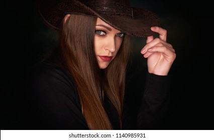 Face of a beautiful girl. with long brown hair. Pretty woman wearing cowboy  hat 31974d2b1bd8