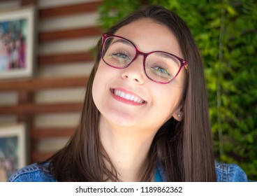 face of a beautiful model wearing glasses