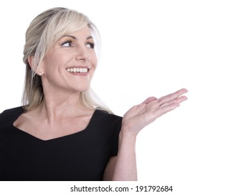 Face of a beautiful older woman looking sideways and presenting with her hand.