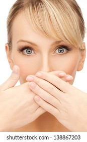 face of beautiful woman covering her mouth