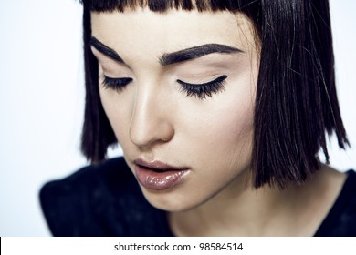 face of beautiful woman over white background