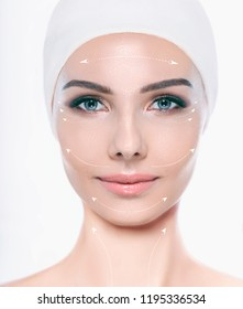 Face of beautiful woman with perfect skin , with lifting arrows on face, concept of facial surgery and face lifting. Cosmetology, elastic and young skin of the face.